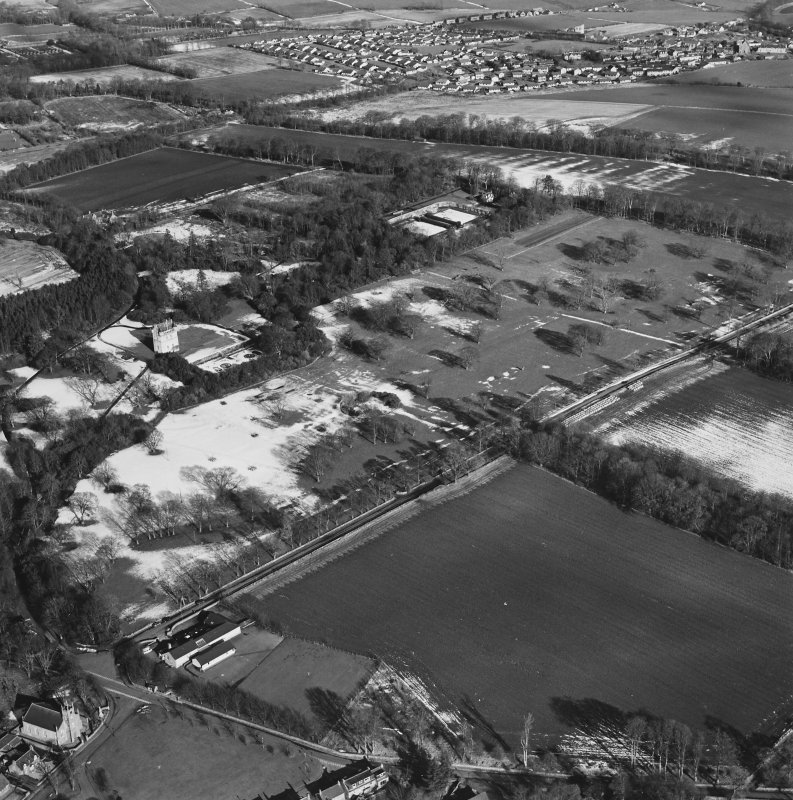 Oblique aerial view centred on Udny Castle and gardens taken from the SW.