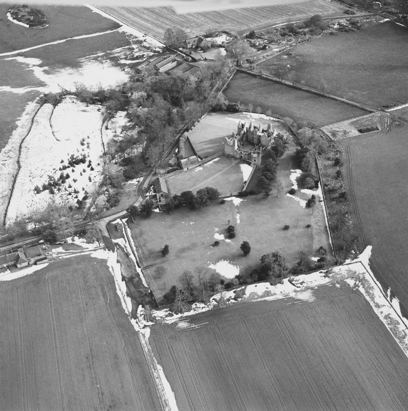 Oblique aerial view centred on the remains of the castle taken from the NW.