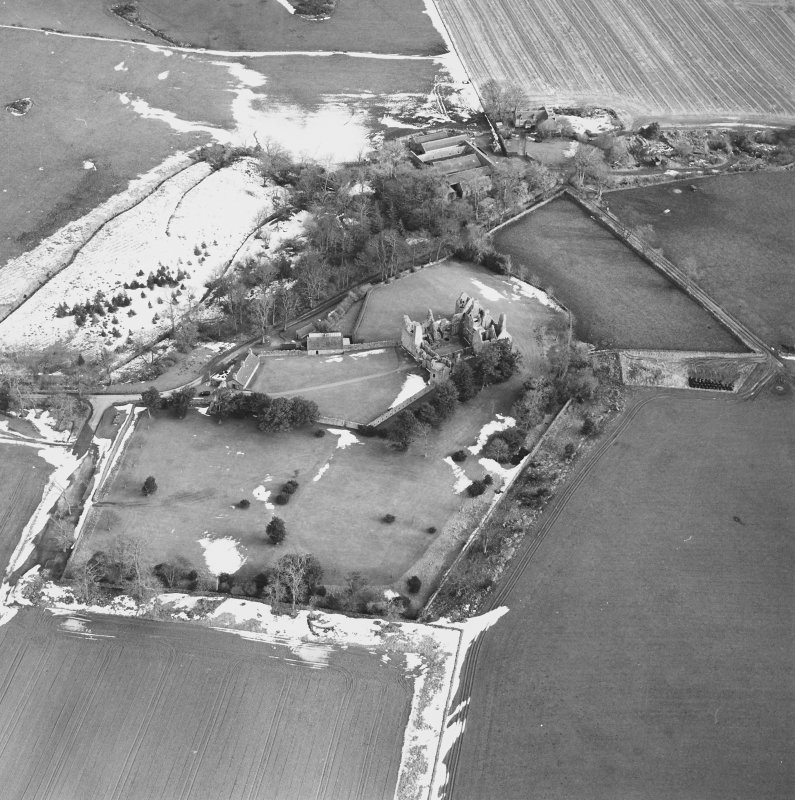 Oblique aerial view centred on the remains of the castle taken from the WNW.