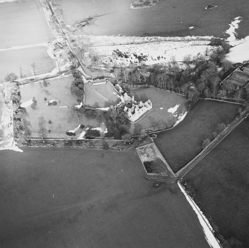 Oblique aerial view centred on the remains of the castle taken from the SSW.