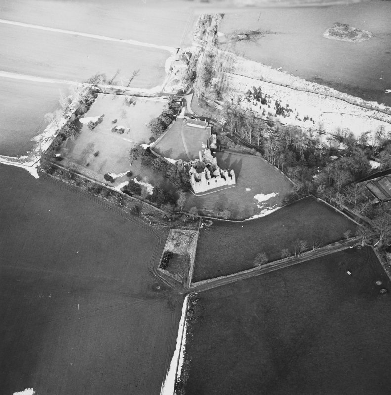 Oblique aerial view centred on the remains of the castle taken from the S.