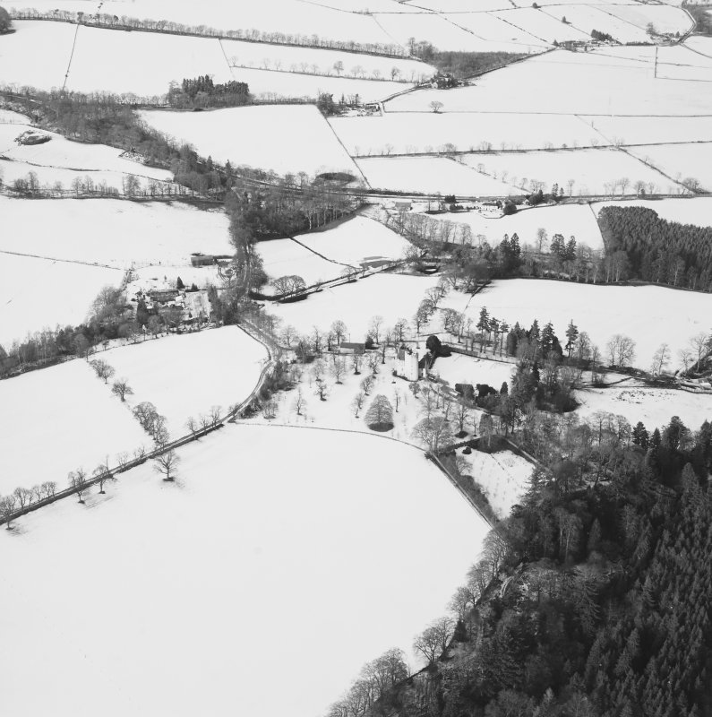 Oblique aerial view centred on the castle taken from the SSW.