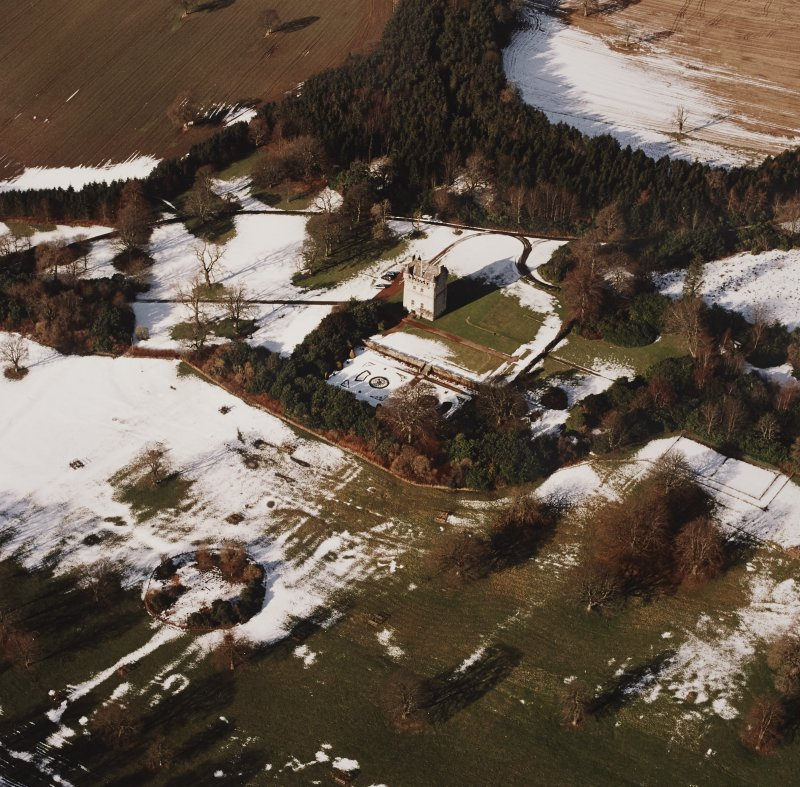 Oblique aerial view centred on Udny Castle and gardens taken from the SE.