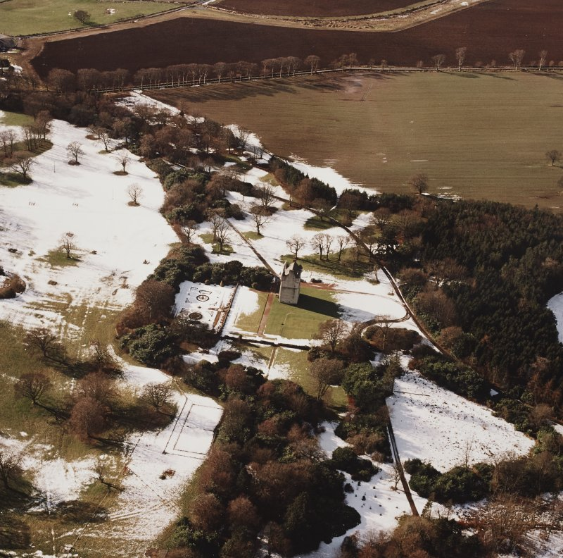 Oblique aerial view centred on Udny Castle and gardens taken from the ENE.