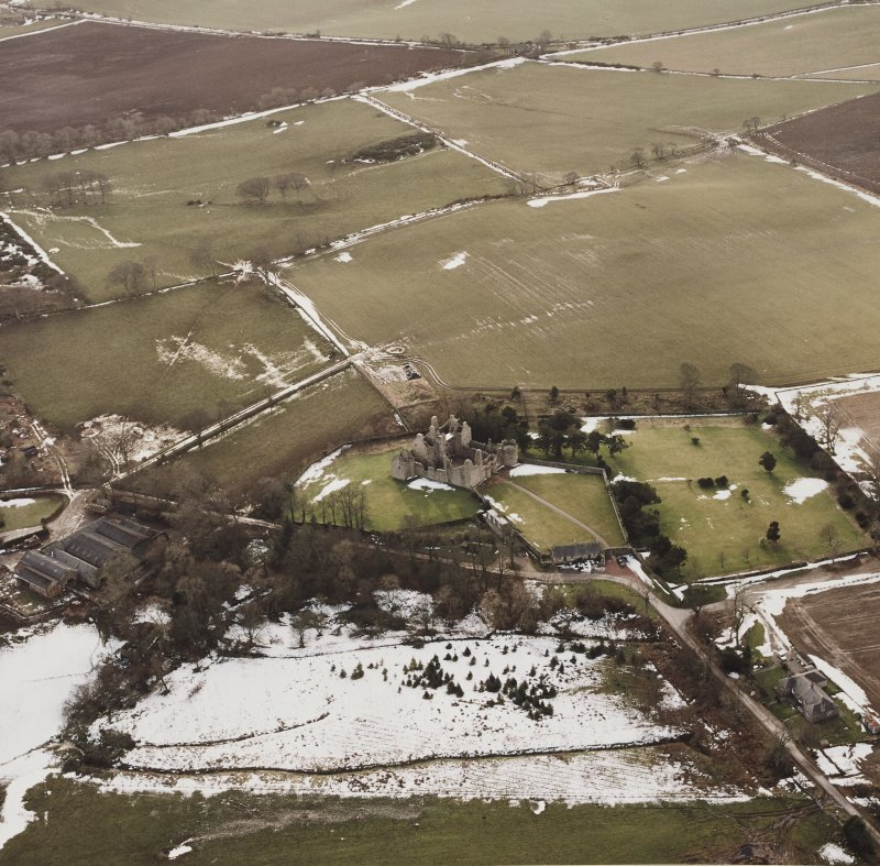 Oblique aerial view centred on the remains of the castle taken from the NE.
