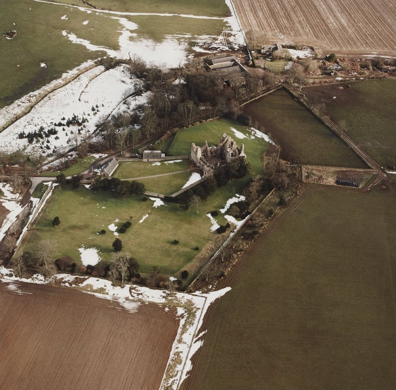 Oblique aerial view centred on the remains of the castle taken from the W.