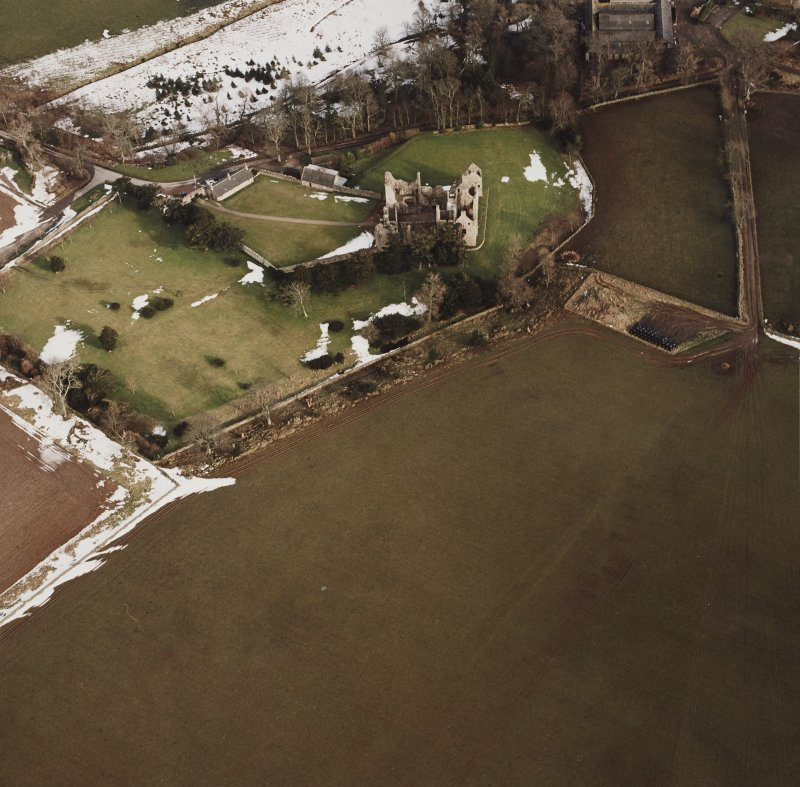 Oblique aerial view centred on the remains of the castle taken from the WSW.