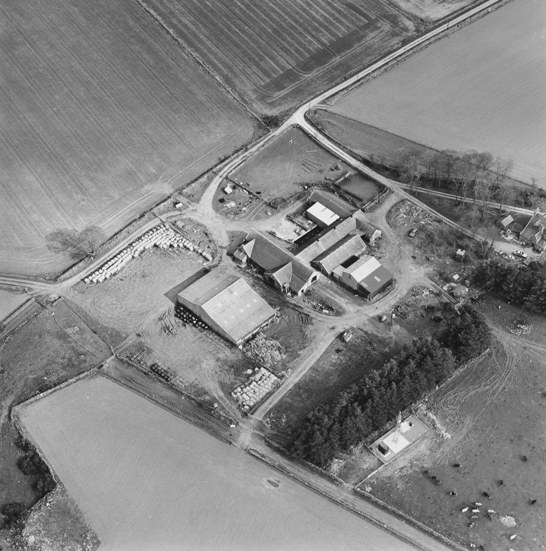 Oblique aerial view centred on the farmstead, taken from the NW.
