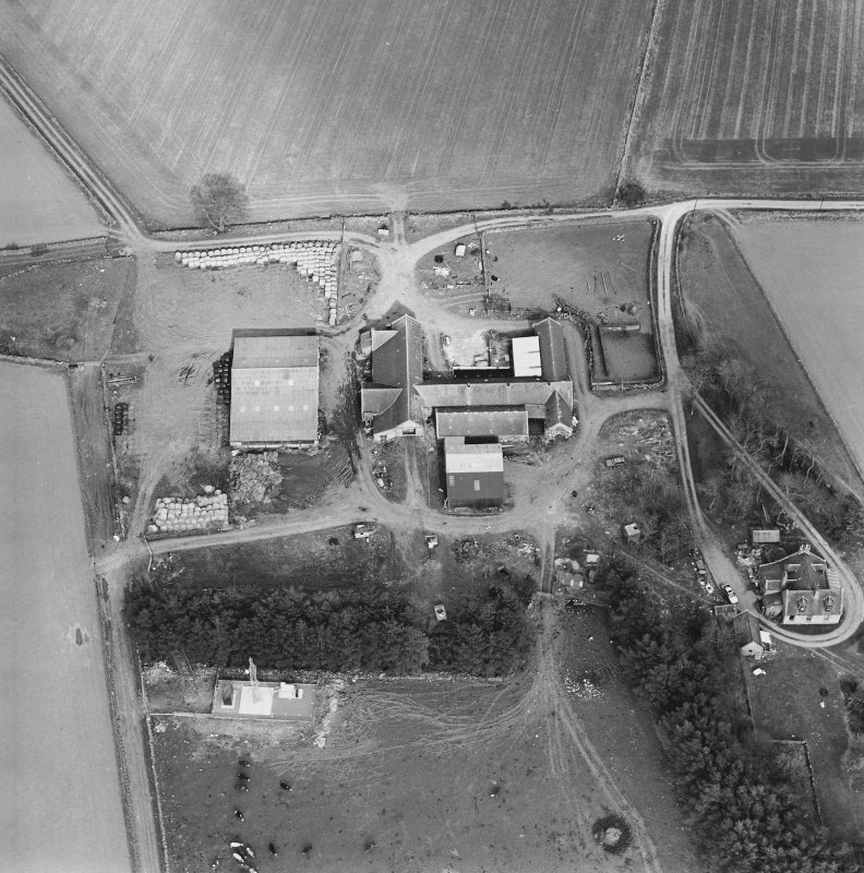 Oblique aerial view centred on the farmstead, taken from the W.
