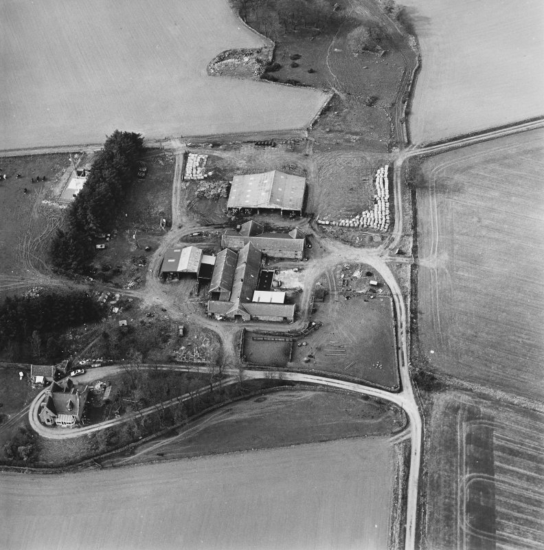 Oblique aerial view centred on the farmstead, taken from the SSE.