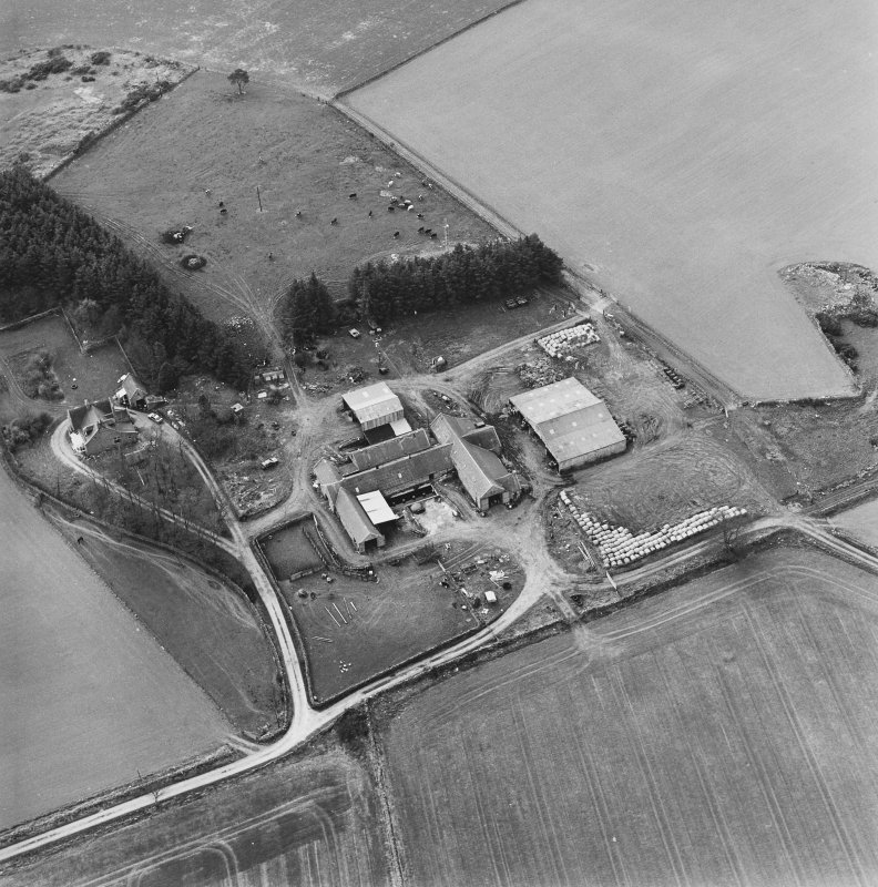 Oblique aerial view centred on the farmstead, taken from the ESE.