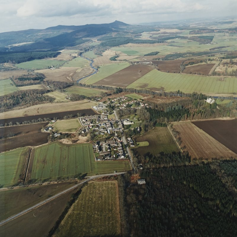 General oblique aerial view looking across Monymusk village towards Bennachie, taken from the S.