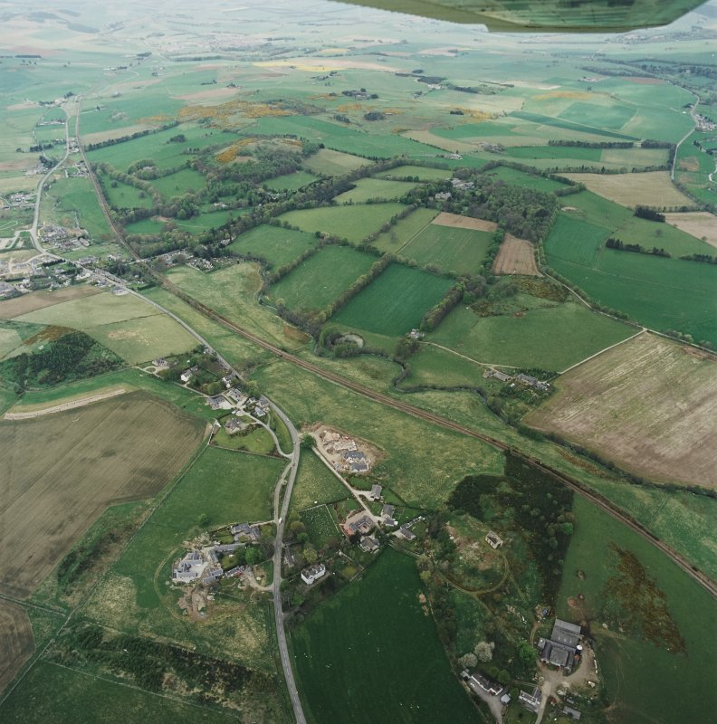 Oblique aerial view of tower-house, country house, home farm and policies, taken from the SE.
