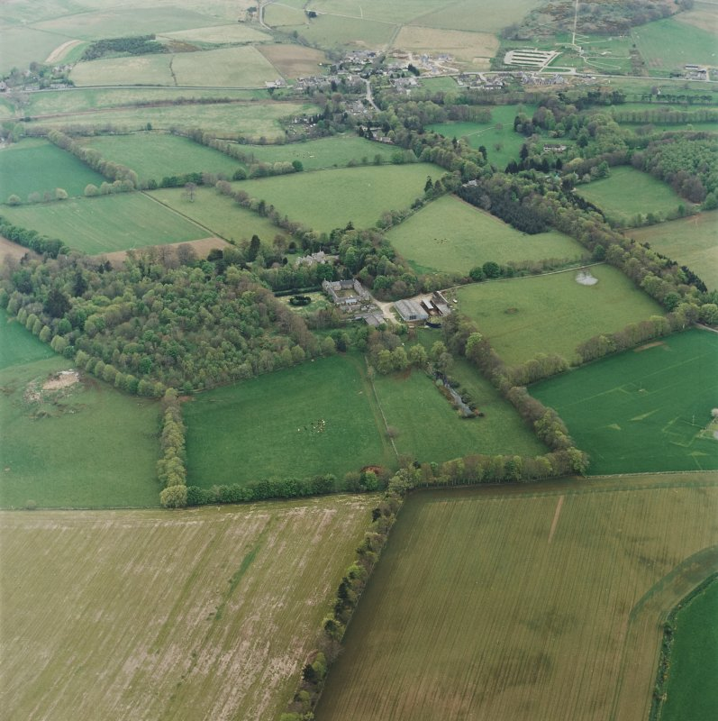 Oblique aerial view of tower-house, country house, home farm and policies, taken from the N.