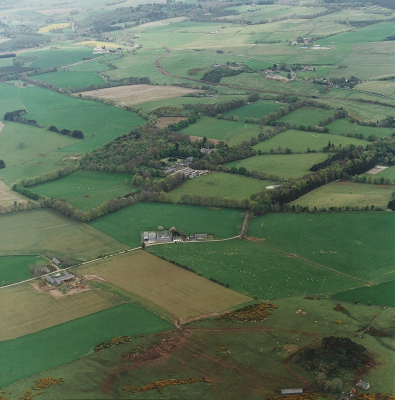 Oblique aerial view of tower-house, country house, home farm and policies, taken from the NNW.
