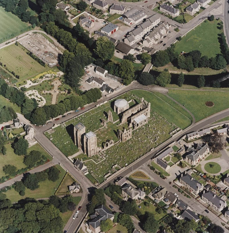 Oblique aerial view centred on the remains of the cathedral and Chapter House, taken from the SW.