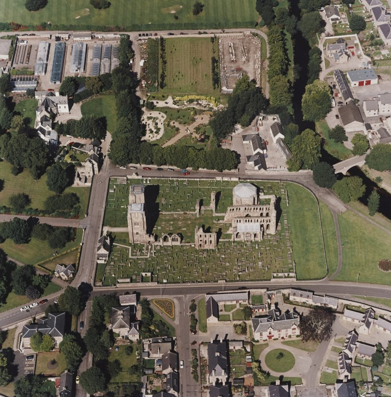 Oblique aerial view centred on the remains of the cathedral and Chapter House, taken from the S.