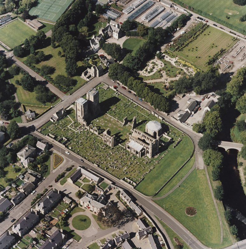 Oblique aerial view centred on the remains of the cathedral and Chapter House, taken from the SE.