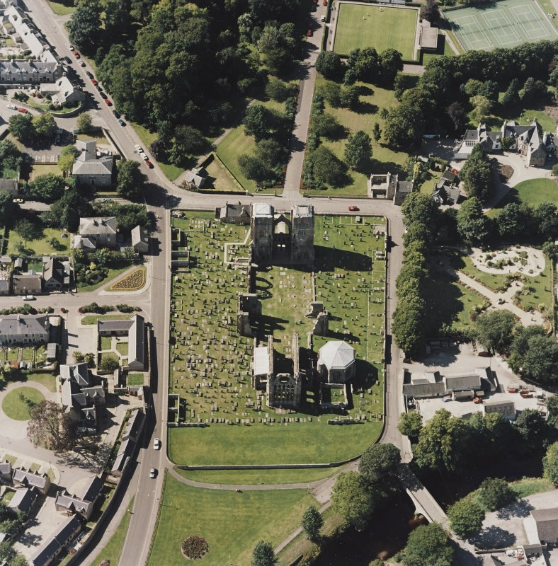 Oblique aerial view centred on the remains of the cathedral and Chapter House, taken from the E.