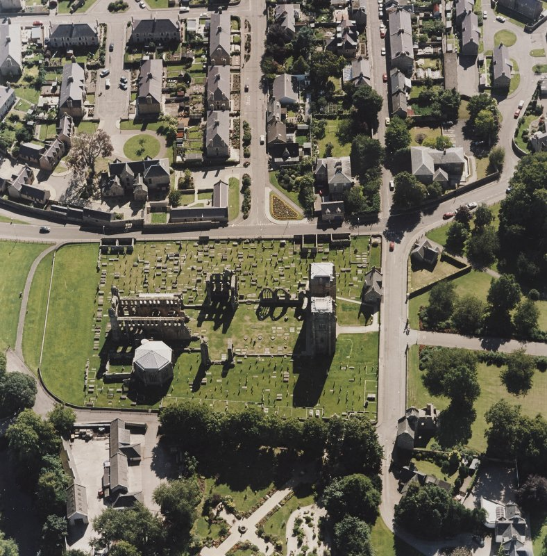 Oblique aerial view centred on the remains of the cathedral and Chapter House, taken from the N.
