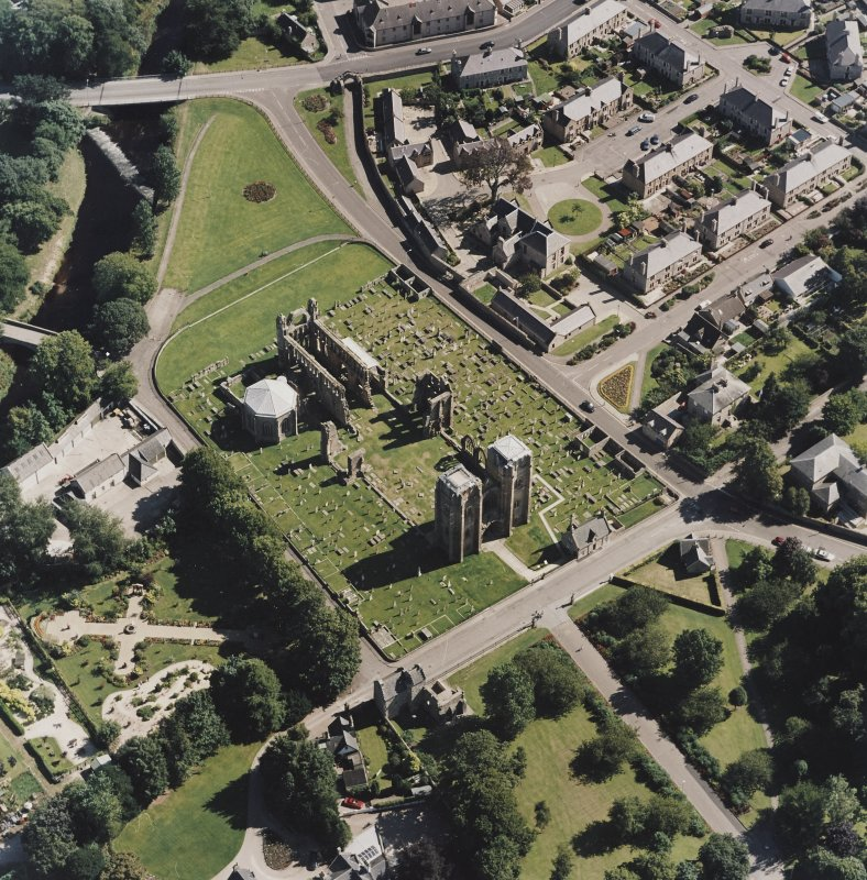 Oblique aerial view centred on the remains of the cathedral and Chapter House, taken from the WNW.