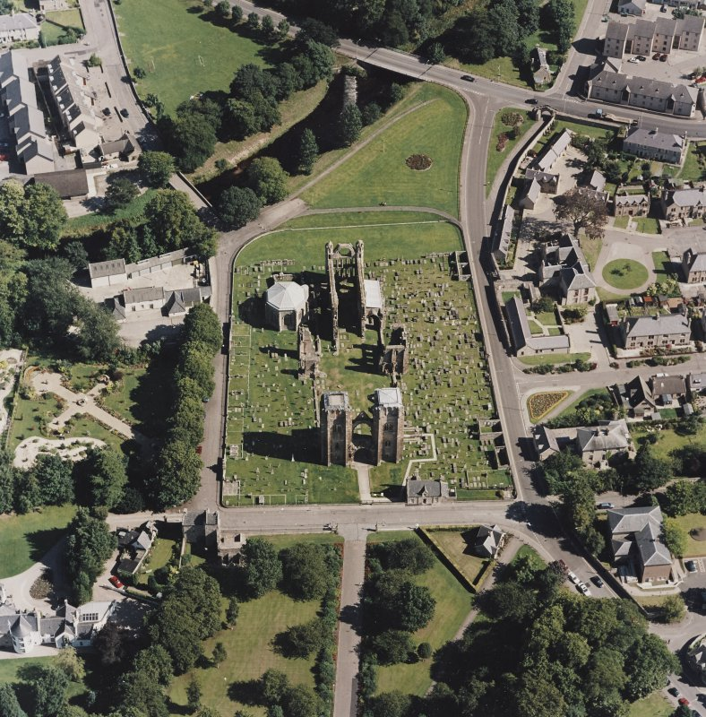 Oblique aerial view centred on the remains of the cathedral and Chapter House, taken from the W.