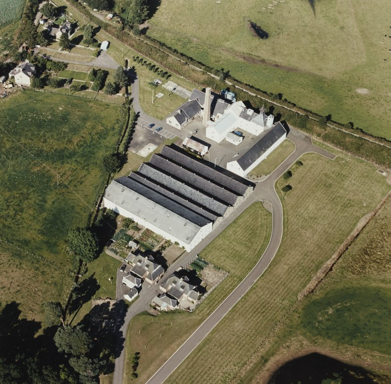 Oblique aerial view centred on Dallas Dhu Distillery.