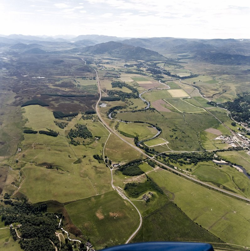 General oblique aerial view looking over the Ruthven Barracks towards Newtonmore, taken from the E.