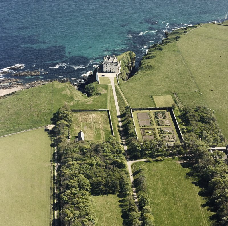 Aerial view of Dunbeath Castle and walled gardens from NW.
