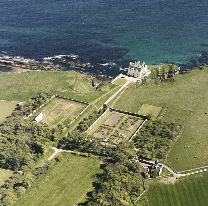 Aerial view of Dunbeath Castle and walled gardens from SW.