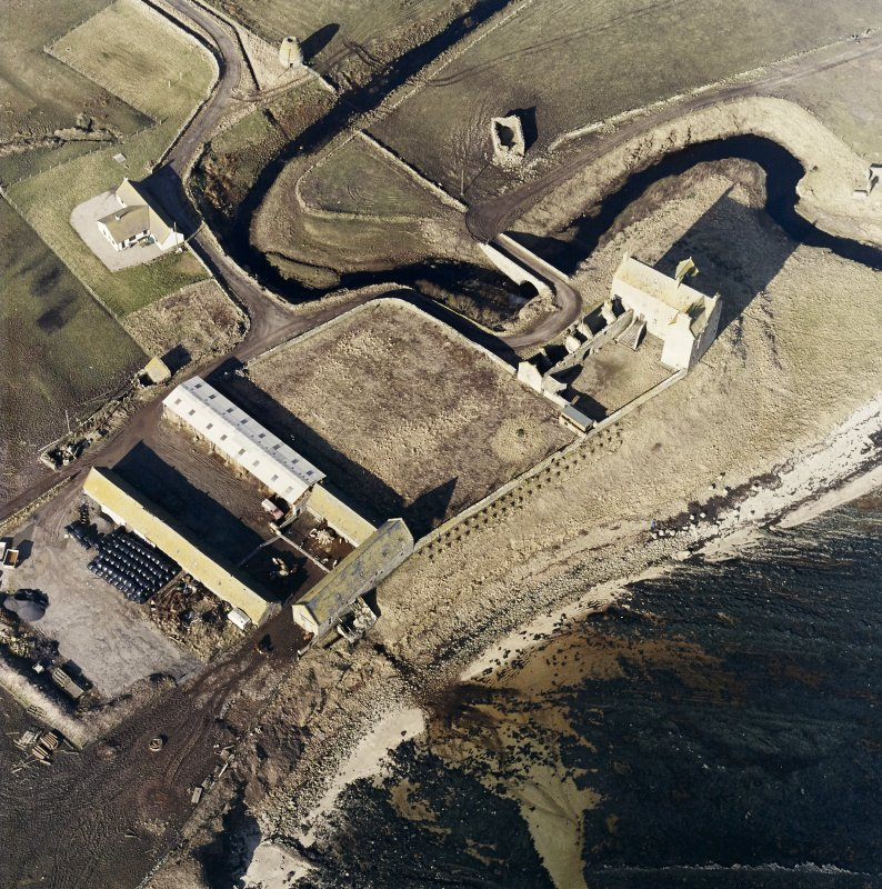 Oblique aerial view of the castle, bridge, farmsteading and the remains of the mausoleum, dovecot and anti-tank blocks, taken from the E.