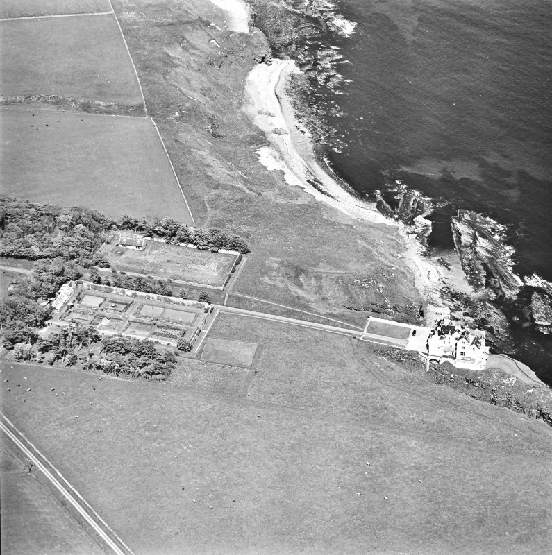 Aerial view of Dunbeath Castle and walled gardens from the SW.