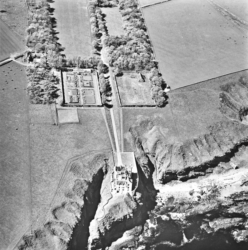 Aerial view of Dunbeath Castle and walled gardens from the SE.