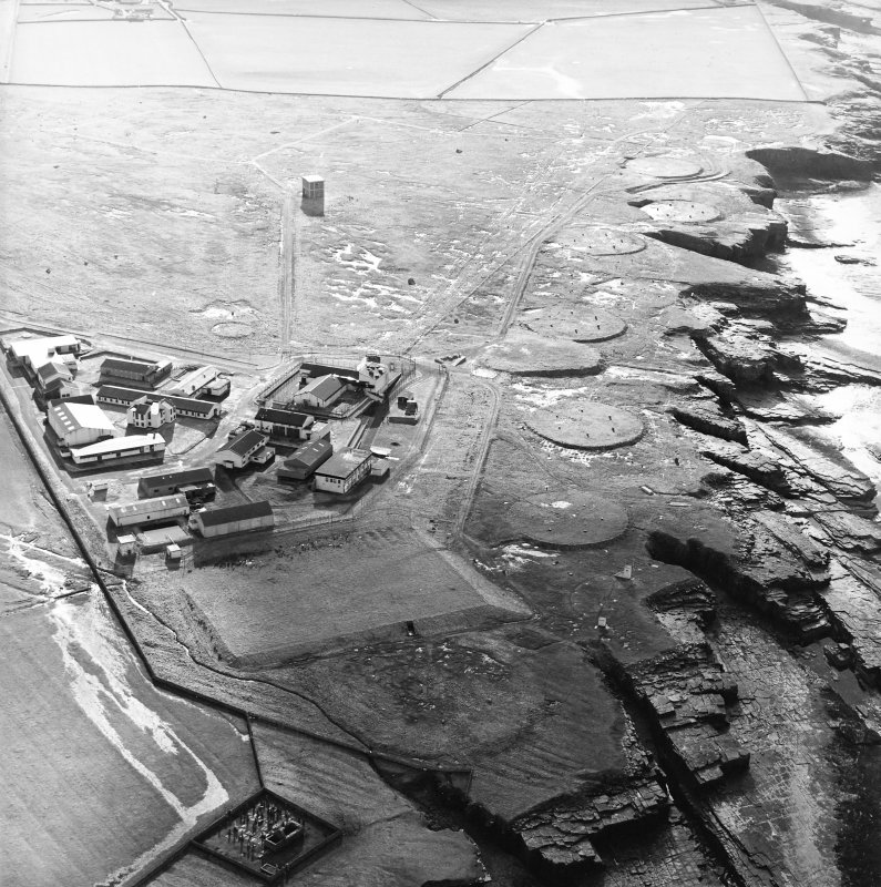 Oblique aerial view of the radio station and the remains of the chapel and the graveyard, taken from the NE.