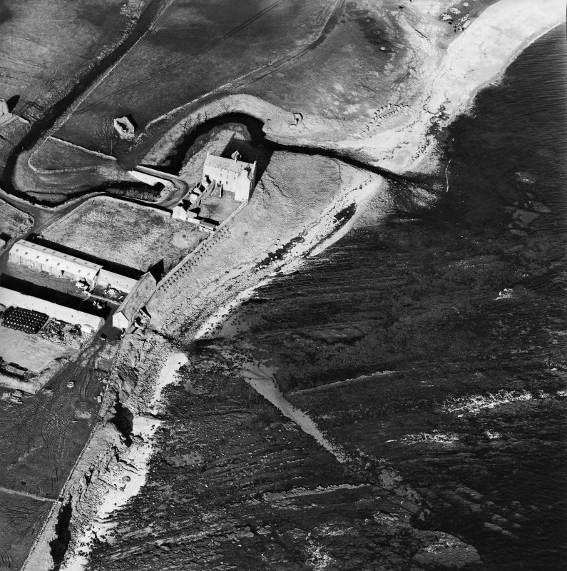Oblique aerial view of the castle, bridge, farmsteading and the remains of the mausoleum, dovecot and anti-tank blocks, taken from the SE.