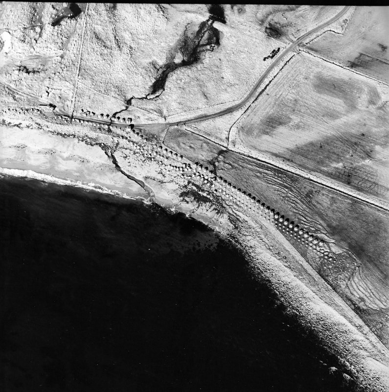 Oblique aerial view centred on the remains of the anti-tank blocks and road block, taken from the E.