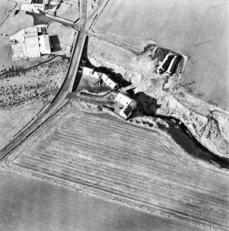 Oblique aerial view of the watermills, bridges, stables and cottage, taken from the E.