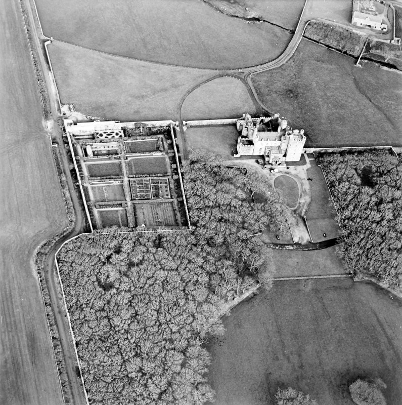 Oblique aerial view centred on the castle and walled garden, taken from the S.