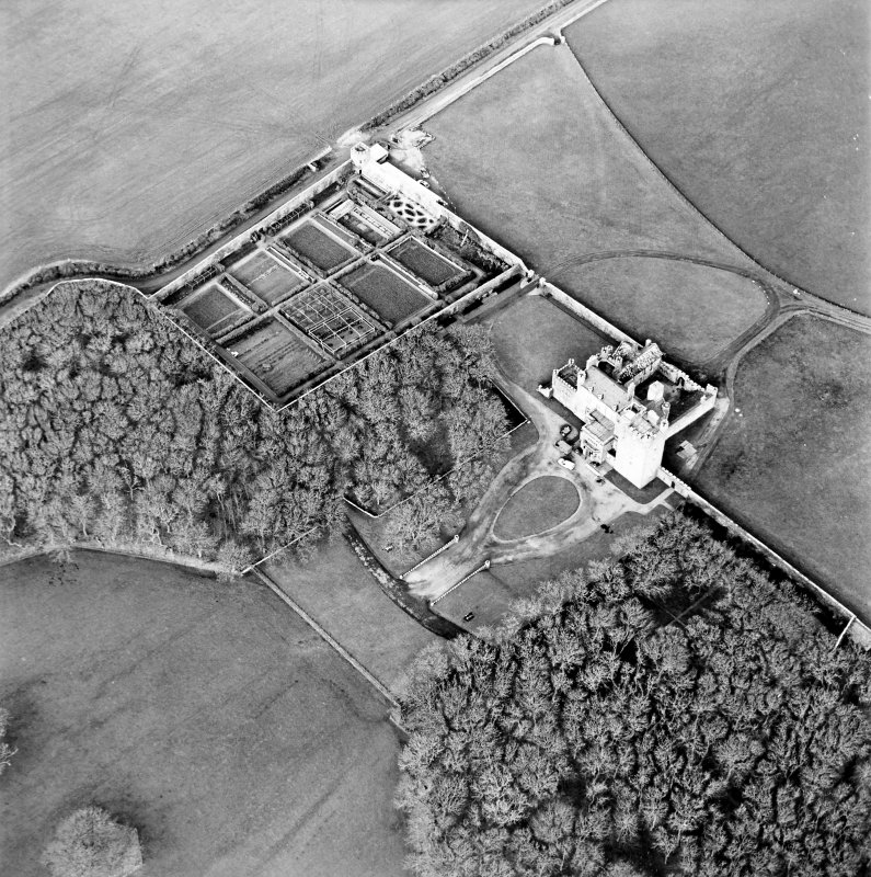 Oblique aerial view centred on the castle and walled garden, taken from the SE.