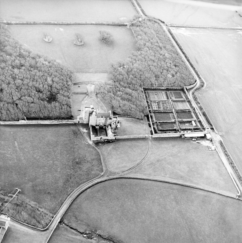 Oblique aerial view centred on the castle and walled garden, taken from the N.
