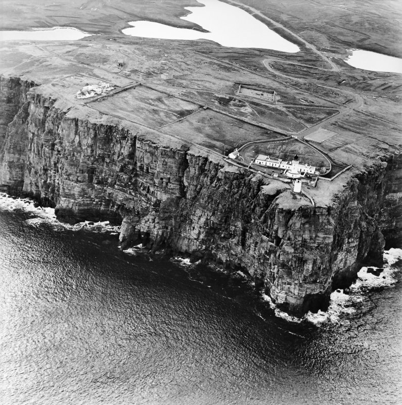 General oblique aerial view looking over the cliffs at Easter Head, Dunnet, to the lighthouse, radar station and the remains of the cairn, taken from the N.