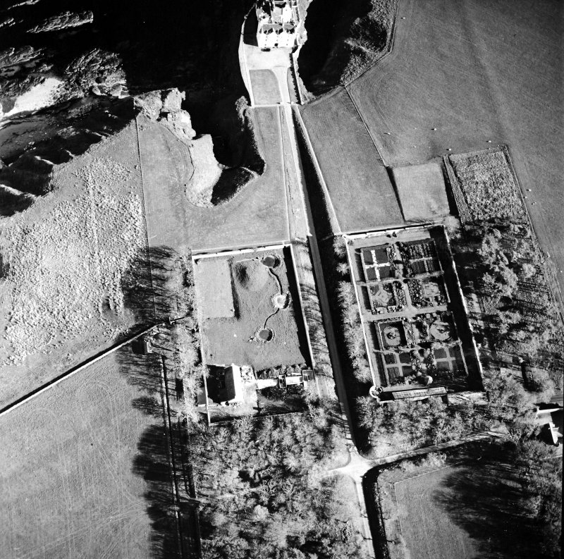 Oblique aerial view centred on the country house, walled gardens and pavilion, taken from the NNW.