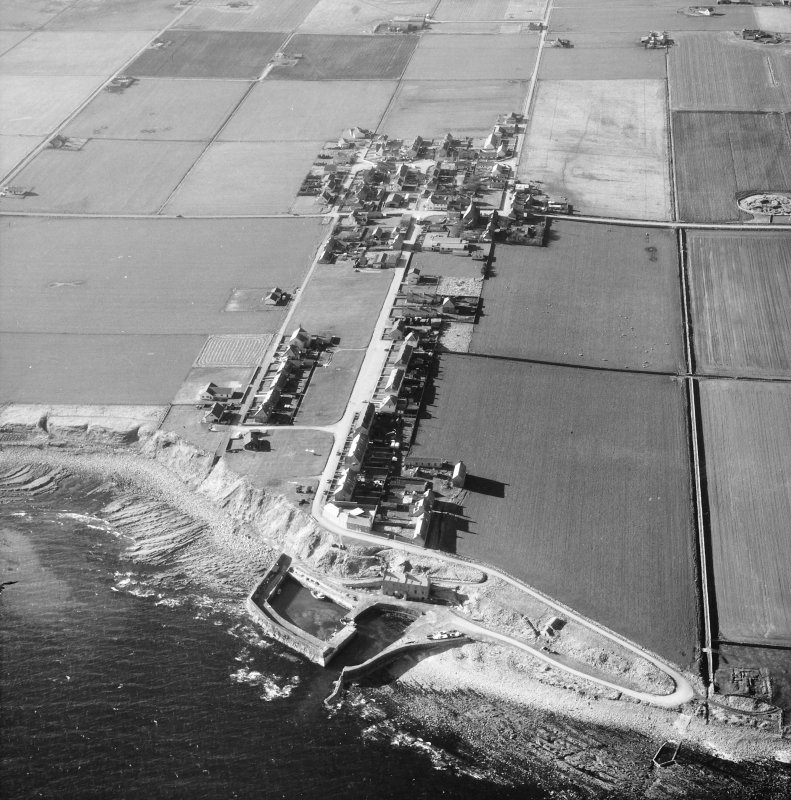 Aerial photograph showing harbour and village