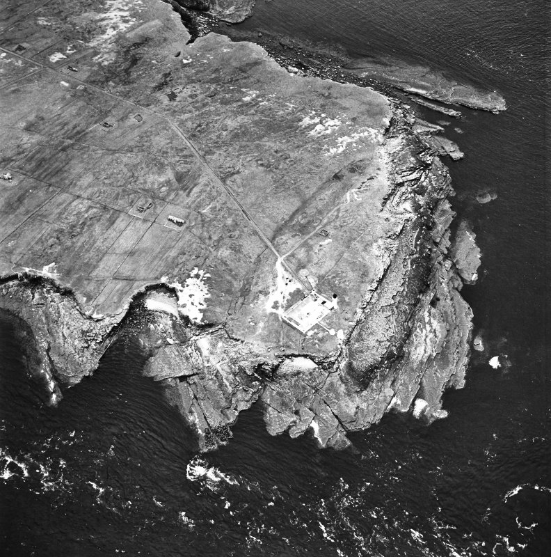 Stroma, oblique aerial view, taken from the NE, centred on the lighthouse, and showing the edge of Nethertown township in the left half of the photograph.