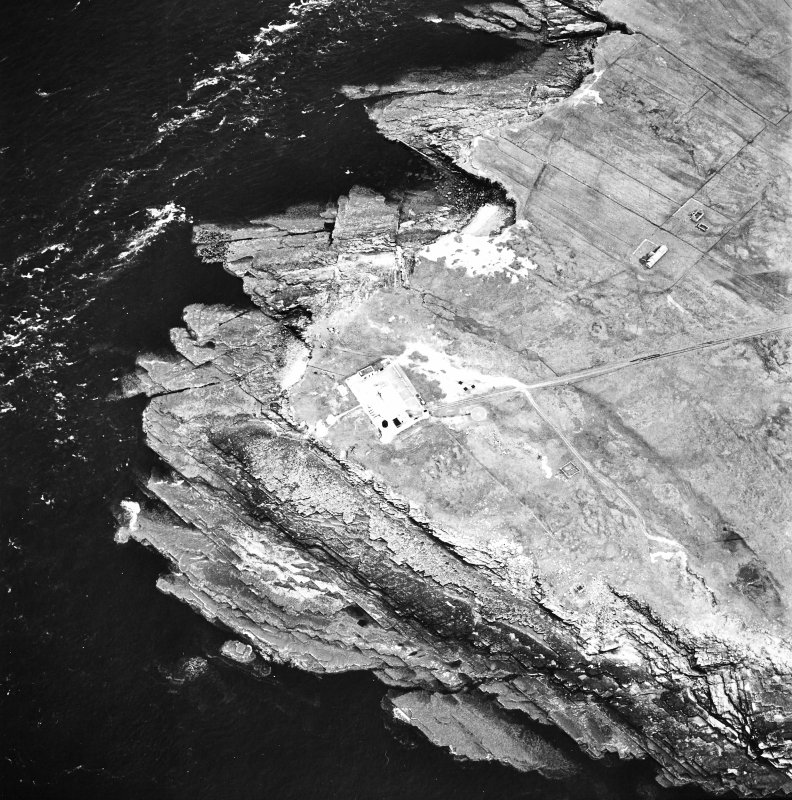 Stroma, oblique aerial view, taken from the NW, centred on the lighthouse, and showing the edge of Nethertown township in the centre right of the photograph.