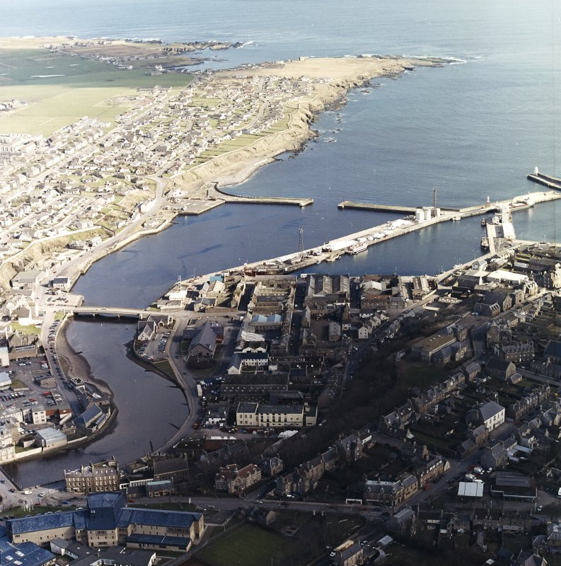 Oblique aerial view centred on the harbour with the town adjacent, taken from the W.