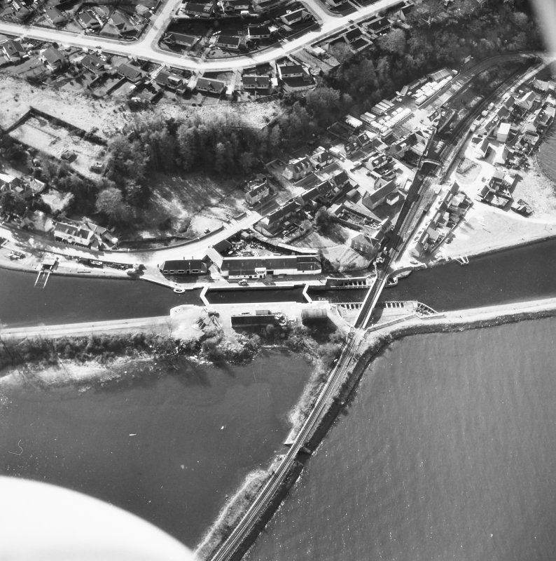 Aerial view showing Clachnaharry Locks, Workshops, Railway Swing Bridge