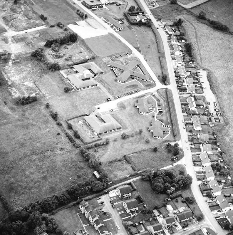 Oblique aerial view centred on the hospital, taken from the NE.