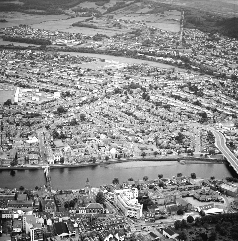 General oblique aerial view of the town, centred on the suspension bridge, churches, mausoleum, road bridge and school, taken from the NW.