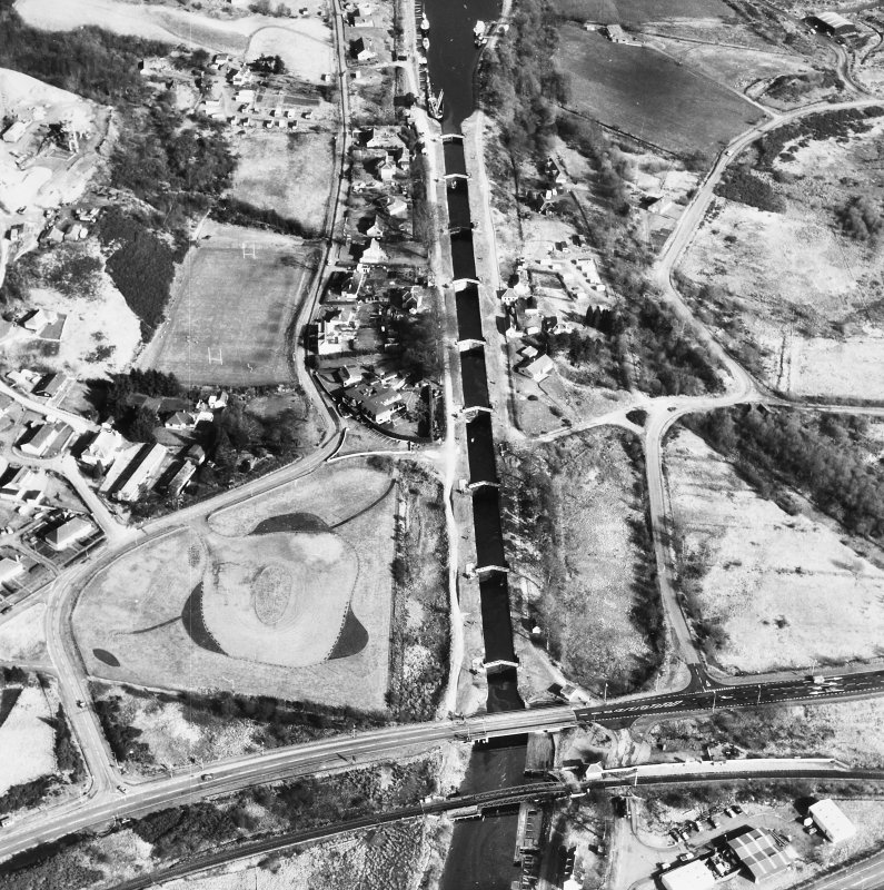 Oblique aerial view showing Neptune's Staircase, Banavie Swing Bridge and Banavie Railway Swing Bridge.